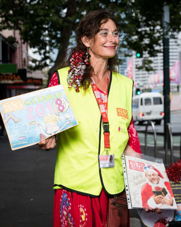 Rachel T sells the Big Issue calendar while wishing passersby a Merry Christmas.