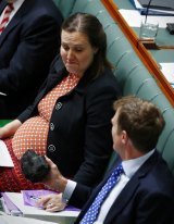 Kelly O'Dwyer, Minister for Revenue and Financial Services, was apparently less keen to hold the lump of coal proffered by Minister for Social Services Christian Porter.