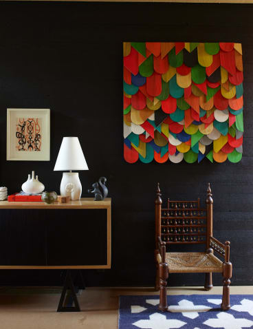 """STYLING TIP: """"Matte black is very light-absorptive and a good backdrop to a rich and diverse use of colour, whereas high gloss black bounces reflected light,"""" says Iain Halliday."""