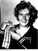 Betty Cuthbert with her gold medal from the Tokyo Olympics.