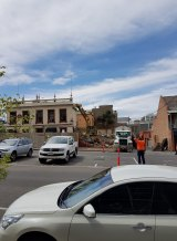 Shaq Demolition midway through knocking down the pub.