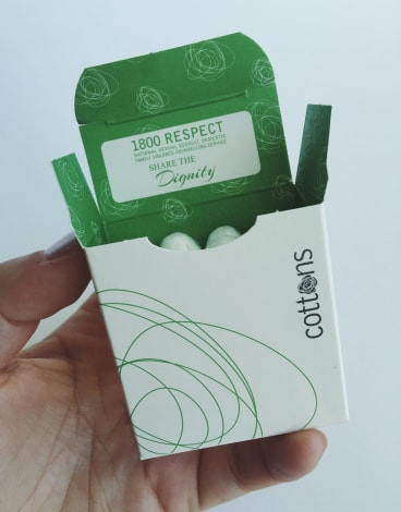 The 1800 RESPECT domestic violence counselling service number has been printed on the inside of Cottons tampon packets in a new initiative.