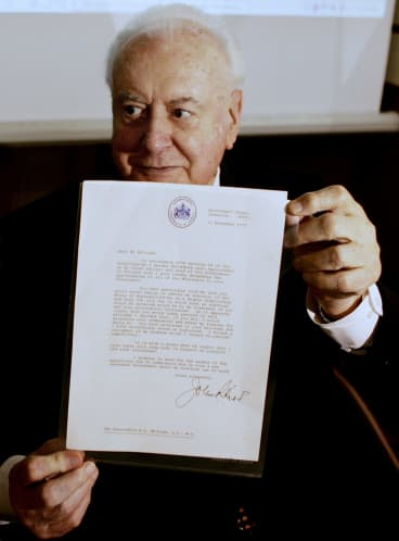 Former prime minister Gough Whitlam with the original copy of his dismissal letter he received from Sir John Kerr at a book launch in 2005.