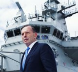 Tony Abbott on the HMAS Canberra Flight Deck before its commissioning ceremony in November 2014.