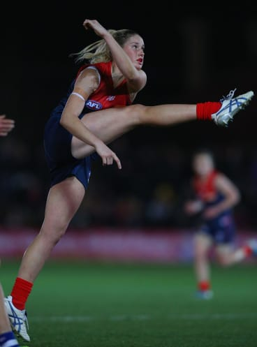 Harris, playing Melbourne during an exhibition game last year, shows her impressive kicking style.