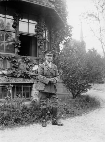 Outdoors portrait of Major General John Monash, commander of the 3rd Australian Division, at his headquarters in the Villers-Bretonneux sector in 1918.