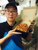 Domino's worker Azrael Yin.