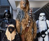 Sydney Star Wars fans (from left) Brenden Graves (Darth Vader), Keira Skidmore (Ewok),  Sarah Hillier (Chewbacca) and Craig Ellis (stormtrooper) experience life in a galaxy far, far away.