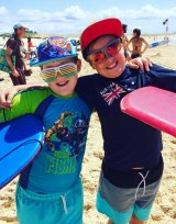 Damien McCaull, left, at the beach on Australia Day.
