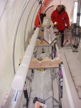 Tas van Ommen with an ice core in a drill tent.