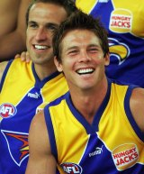 Chris Judd and Ben Cousins smile during a team photo in 2004.