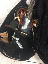 Jon English posted a photo of his smashed-up Ovation guitar after he collected it from a baggage carousel at Sydney Airport.