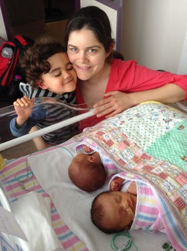 Amanda Robinson with her oldest son, Jasper, and twins Luca and Tristan.