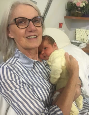With her newest grandson, three months ago.