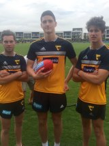 Hawk draftees (from left): Teia Miles, Marc Pittonet and Daniel Howe.