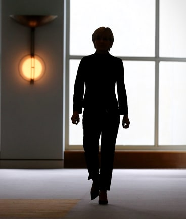 Julie Bishop approaches the media for the press conference.
