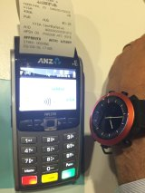 A payments terminal will recognise a tap of the Optus watch and print a receipt.