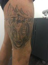 This man had 'to' spelled incorrectly on large tattooes on each of his thighs.