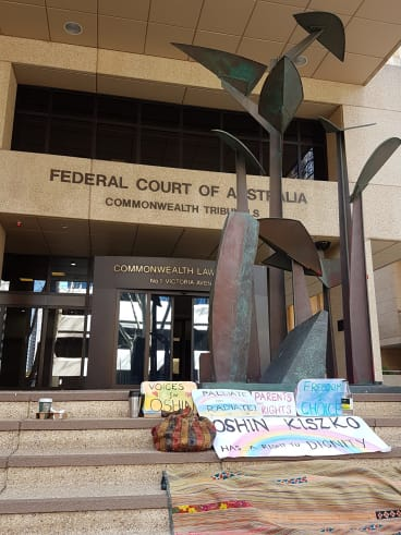 A small protest waged by friends of the family outside the court at last week's hearings.