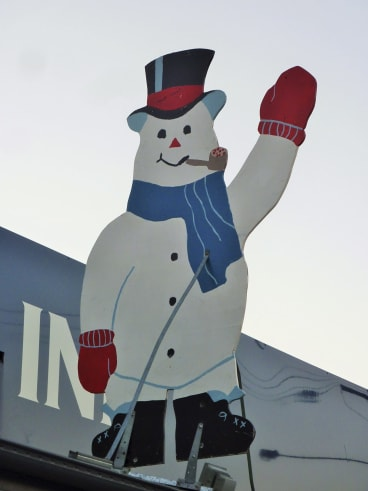 Friendly face: One of the dozens of snowmen that adorn the main street of Cooma.