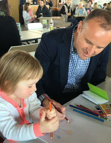 Andrew Barr shows his niece Zoe Barr, 2, how to draw a tram.