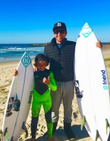 Chris Hasson, pictured with Eden, 10, said his son has already been back in the water and sharks must be respected.