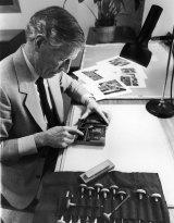 Tate Adams at work on a wood engraving.
