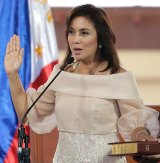 Leni Robredo is sworn in as Vice-President in June. She will keep that job - which is elected separately to the presidency - but quit her cabinet post.