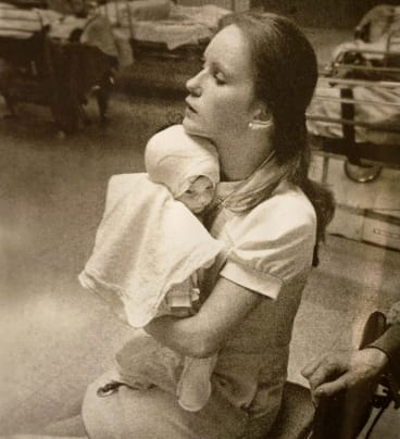 In this photo taken at Albany Medical Centre in 1977, nurse Susan Berger cuddles Amanda Scarpinati, who had been severely burnt by a steam vaporiser at home.