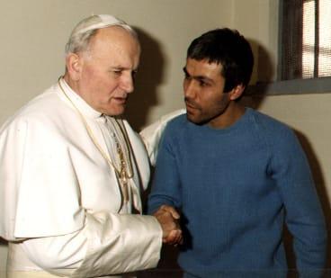 Pope John Paul meets Mehmet Ali Agca who  tried to assassinate him.