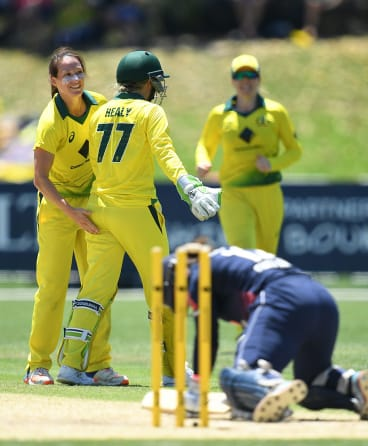 Got her: Megan Schutt (left) celebrates the wicket of Tammy Beaumont - her new-found teammate.