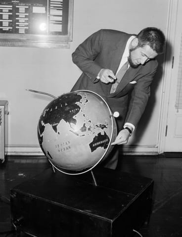 Professor Harry Messel pictured at Sydney University on 15 October 1957 with a working model of Russia's Sputnik.