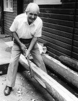 Carl Halvorsen cutting a mast.
