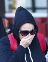 Mitra Alavi, sister of murdered hairdresser Leila Alavi, leaves the NSW Supreme Court on Thursday.