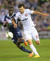 Canberra's Jason Geria of the Victory and Labinot Haliti compete for the ball in round one of the A-League season.