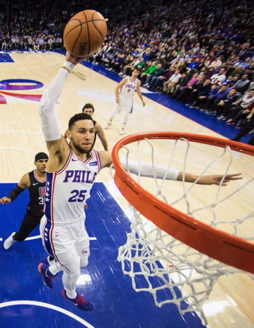 Smooth: Simmons goes up for a dunk in Philadelphia.