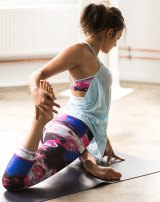"""""""Moving your body in a really joyful way is a great way to develop a better body image,"""" psychologist and curvy yoga instructor Sarah Harry says."""