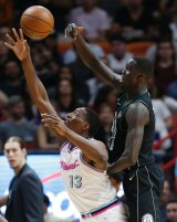 Tall timber: Milwaukee Bucks center Thon Maker bats the ball away from Miami Heat center Bam Adebayo.
