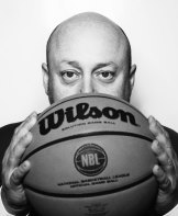 After watching his son play basketball, Larry Kestelman liked the sport so much he bought the NBL.