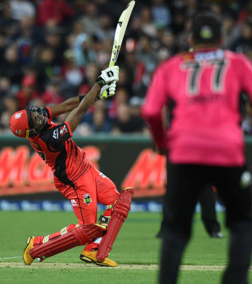 Renegades' Dwayne Bravo scores the winning runs during their BBL match against the Sixers.