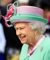 Queen Elizabeth II wearing a pink and green outfit.