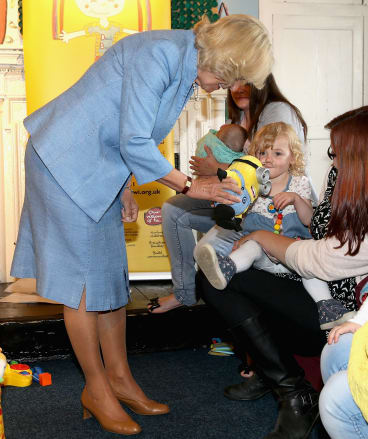 They get around: Camilla, Duchess of Cornwall meets a young girl with a Minions toy.