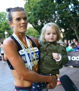 Eloise Wellings, with daughter India after winning the SMH Half Marathon on May 17, 2015, says the Zika virus outbreak the outbreak is disconcerting.