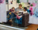 Felix and Riha, both 4, learn while they read with Gracie Pupillo at Flemington Street Children's Centre.