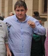 Former AFL footballer Billy Nicholls outside court.
