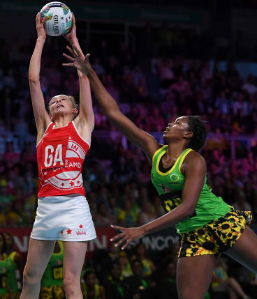 England's Helen Housby (left) and Jamaica's Stacian Facey during the Fast5 Netball World Series final.