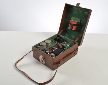 """A Leica II kit including camera No. 838374 (1932) in a fitted leather suitcase with Summitar, Elmar and Hektor lenses, Leica cassettes, sunshade, filter and lens cap. Estimates $2000 to€"""" $3000."""