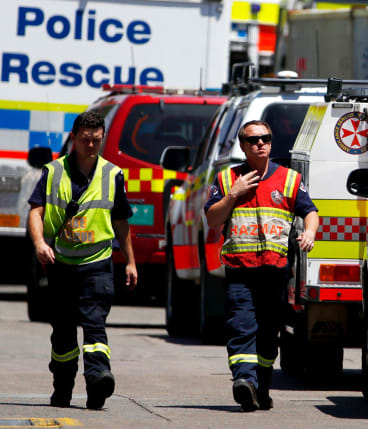 Rescue workers at DIC headqarters where three men were trapped in a tank.