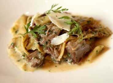 Rough-cut breadcrumb pasta with goat ragu.