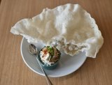 Crispy sesame and coconut rice papers with Spanner Crab dressed with coconut, chilli and lime.